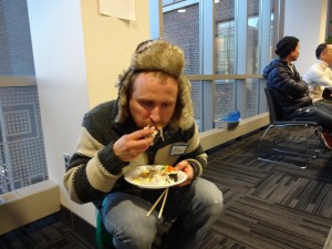 university of minnesota twin cities, coffman memorial union, CLA, Homeless Man Shares Diet of Free Food At UofMN Events, non-student, revealed his dietary secrets.economical and 'healthier then dumpsters,Pizza, Bagels, Chips, and Diet Coke, and Jimmy Johns, college life, eat for free, how to never pay for food, controversial, nonexistent screening process, don't ask for student ID, McCalister, MCTC's,free dining every dAY, best places in minnesota to eat free food, come grab 3 slices of pizza and leave, alternates between his only two coats, to avoid being recognized, alter egos with backstories.emergencies, feast of nations, umn events calendar, fun things to do, get arrested, cnn, breaking news, satire, STSS, pizza crust stock images, homeless man stock photo, crazy bum, no table manners, line eat, asian cuisine, mississippi room, 3rd floor, buffet, misa, hat with ears russian, chopsticks, sushi rolls, rice, soy sauce, eats like a pig stock, eating alone stock, crouching while eating